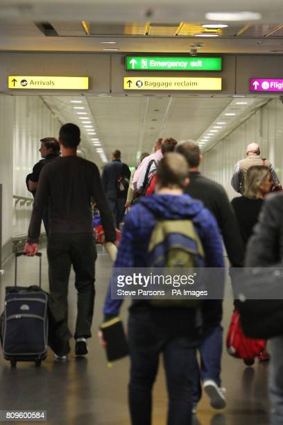 Passengers arrive off a Qantas plane at London's Heathrow Airport following last weekend's industrial action by the airline's staff