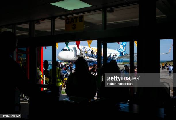 Passengers arrive on a JetBlue Airways plane from New York City at the Maurice Bishop International Airport in St. Georges, Grenada February 18,...