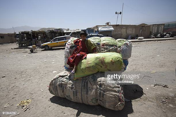 Passengers arrive with cargo in Kabul AfghanistanÕs Company bus terminal having traveled from the countryÕs southern provinces originating in...