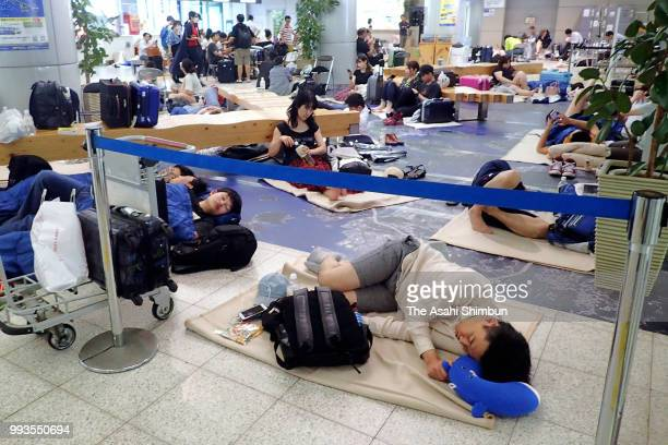 Passengers arrived at Hiroshima Airport spend time at the airport as transport service have been suspended due to heavy rain on July 7 2018 in Mihara...