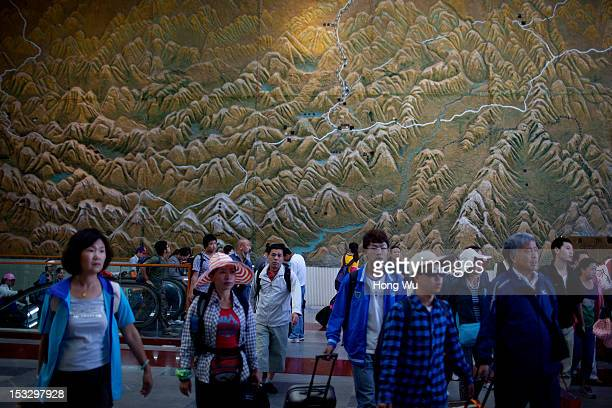 Passengers arrived at Lhasa Railway Station after taken a train from Beijing to Lhasa on August 15 2012 in Lhasa China After QinghaiTibet Railway...