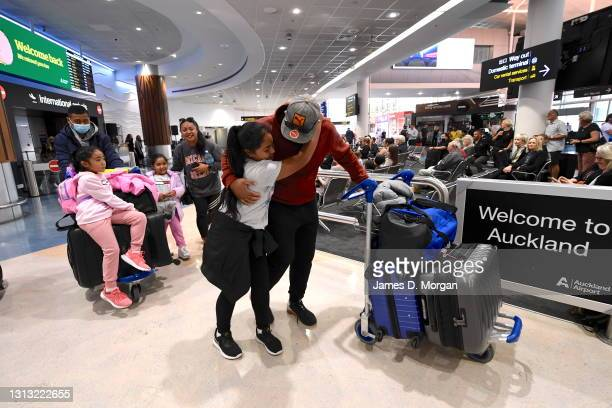 Passengers arriving from Australia are greeted by friends and relatives at Auckland Airport on April 19, 2021 in Auckland, New Zealand. The...
