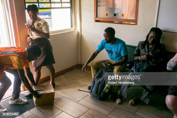 Passengers arriving from Grenada wait for their cargo and baggage February 2 2018 on the island of Carriacou Grenada Carriacou is one of three...
