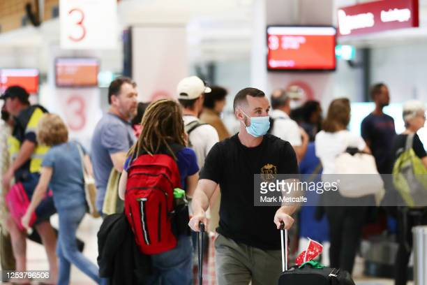 Passengers arriving from Melbourne collect their baggage at Sydney domestic airport on July 02, 2020 in Sydney, Australia. The NSW state government...