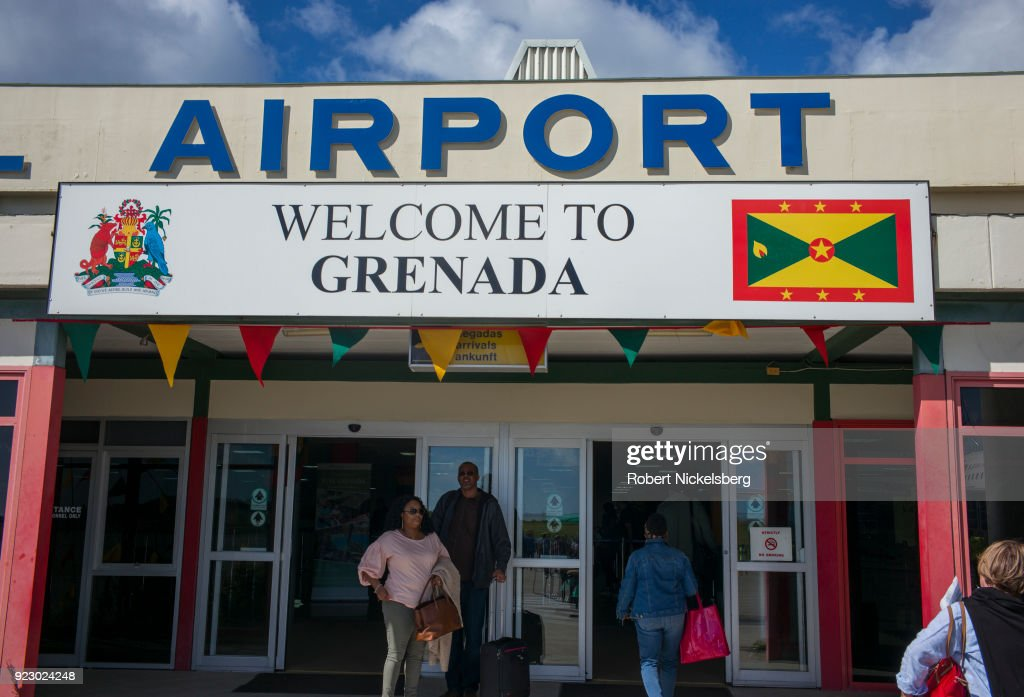 Passengers arriving on a JetBlue Airways flight from New York walk to the immigration counters February 1, 2018 at Maurice Bishop International Airport in St. George's, Grenada.