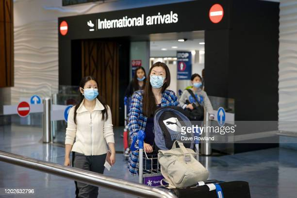 Passengers arriving on flights wear protective masks at the international airport on January 29 2020 in Auckland New Zealand There have been no...
