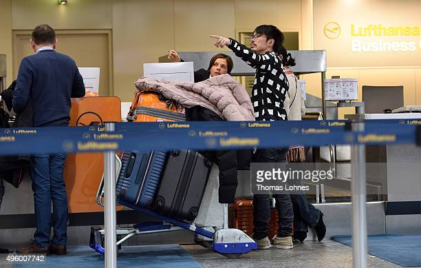 Passengers ask at a checking counter of the German airline Lufthansa at Frankfurt Airport during an strike of Lufthansa flight crews over salaries at...