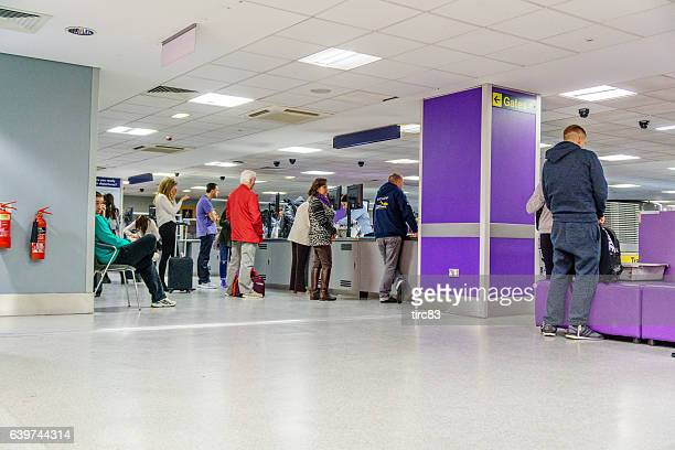 Passengers at Airport Security screening