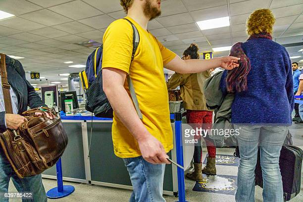 passengers at airport security screening - editorial stock pictures, royalty-free photos & images