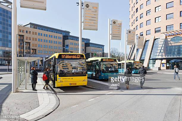 passengers at bus station downtown amersfoort, the netherlands - amersfoort netherlands stock photos and pictures