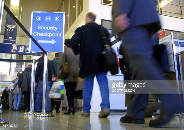 Passengers at Chicago's O'Hare airport wait in line to pass through a security checkpoint for American Airlines 12 November 2001. Lines to the...