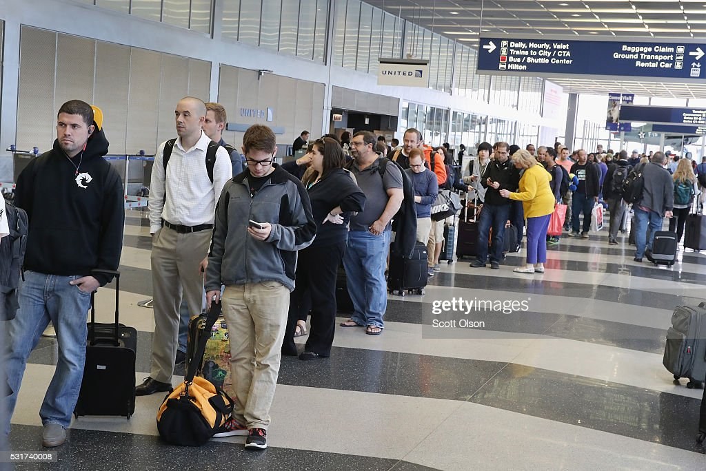 Passengers at O'Hare International Airport wait in line to be screened at a Transportation Security Administration (TSA) checkpoint on May 16, 2016 in Chicago, Illinois. Waiting times at the checkpoints today have been reported to be as long 2 hours. The long lines have been blamed for flight delays and a large number of passengers missing flights completely.