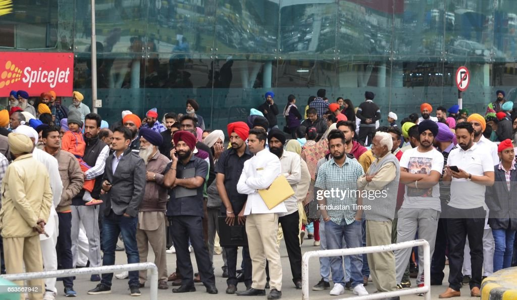 Passengers at the airport holded back by the security personnel during suspected bag which was found in the parking of Sri Guru Ram Das Ji...