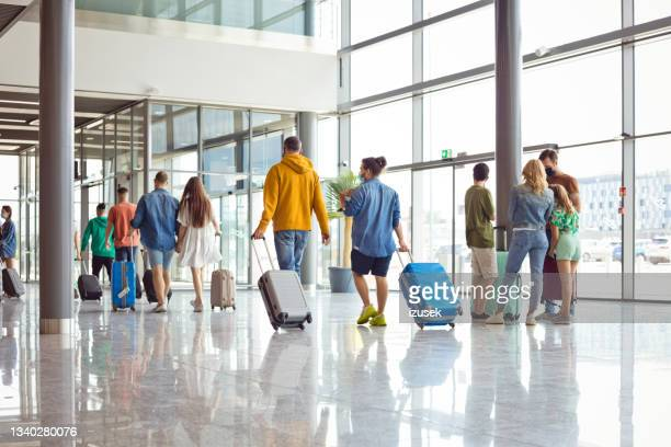 passengers at the airport with luggage - izusek stock pictures, royalty-free photos & images