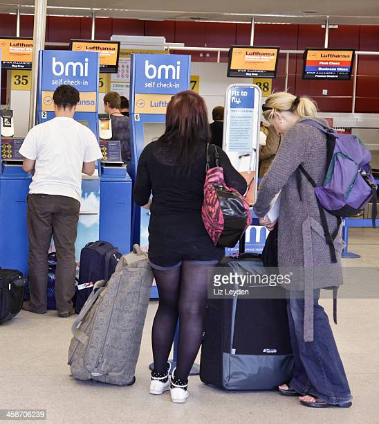passengers at the bmi self check-in facility; edinburgh airport - editorial stock pictures, royalty-free photos & images