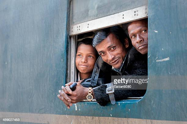 Passengers at the window of coach, Bangladesh