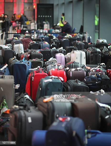 Passengers baggage piles up in the departure lounge of Terminal 3 at Heathrow airport on December 21 2010 in London England Heathrow airport will...