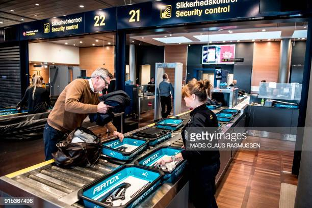 Passengers' belongings are checked during the opening ceremony of a new and extended zone of security control at Copenhagen Airport on February 7...