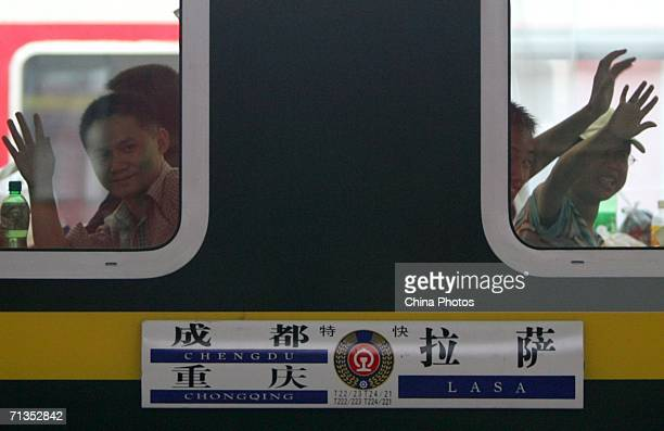 Passengers bid farewell to friends and relatives on the train from Chongqing to Lhasa at Caiyuanba Railway Station on July 2 2006 in Chongqing...