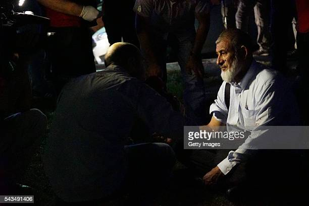 A passenger's blood pressure is checked by health officals outside Turkey's largest airport Istanbul Ataturk on June 28 2016 in Istanbul Turkey Three...