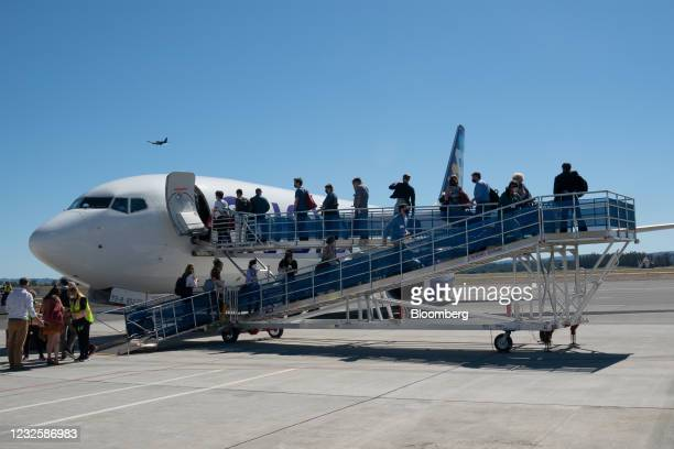 Passengers board a Boeing Co. 737-800 jetliner operated by Avelo Airlines at Charles M. SchulzSonoma County Airport in Santa Rosa, California, U.S.,...