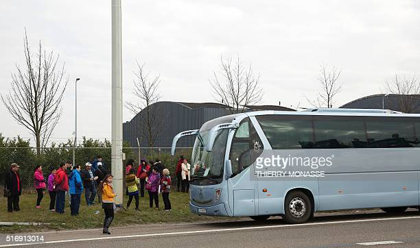 Passengers board a bus as they evacuate the Brussels Airport in Zaventem on March 22 after a string of explosions rocked Brussels airport and a city...