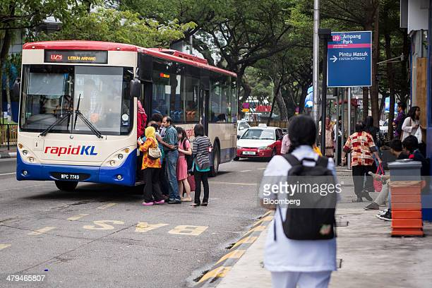 Passengers board a bus operated by Rapid Bus Sdn. Bhd. In Kuala Lumpur, Malaysia, on Tuesday, March 18, 2014. Malaysia, aspiring to become a...