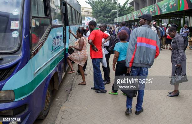Passengers board a bus Street scene in Nairobi capital of Kenya on May 15 2017 in Nairobi Kenya