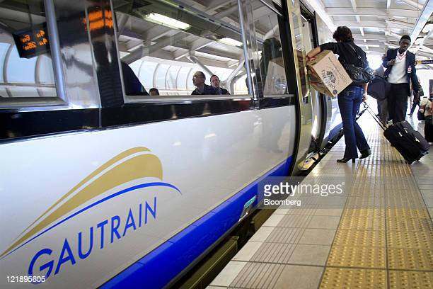 Passengers board a Gautrain passenger train at OR Tambo International Airport near Johannesburg South Africa on Monday Aug 22 2011 South Africa...