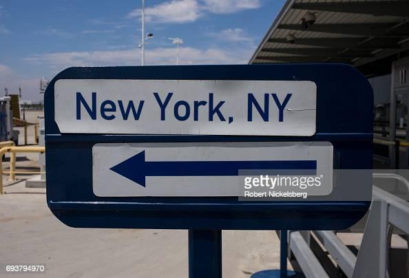 Passengers board a JetBlue Airways flight to New York May 24