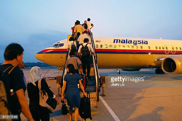 Passengers board a Malaysia Airlines aircraft in the eastern city of Kuantan 18 August 2004 Malaysia Airlines reported a net profit of 2659 million...