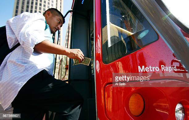 LOS ANGELES CA SEPTEMBER 15 2014 Passengers board a Metro Rapid Bus at the Patsaouras Transit Plaza a bus station located on the east side of Union...
