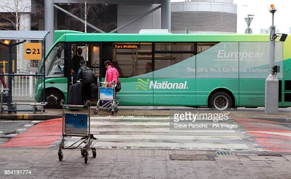 Passengers Board A National Car Hire Shuttle Bus At Heathrow Airport