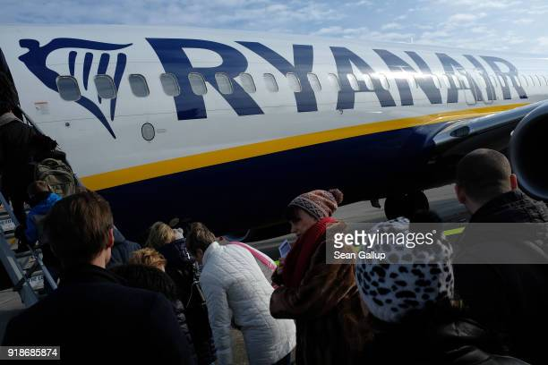Passengers board a Ryanair flight at Schoefeld Airport near Berlin on February 15 2018 Schoenefeld Germany Ryanair is expanding its routes network...