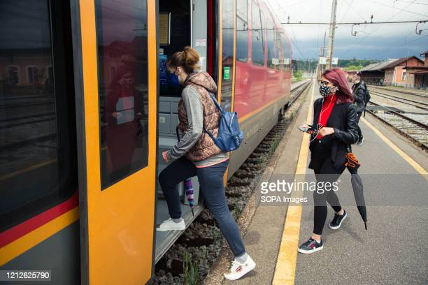 Passengers board a train while wearing face masks as a preventive measure as public transportation resumes in Slovenia. Public transport in Slovenia...