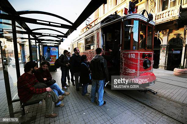 Passengers board a tram on Istiklal Street in Istanbul on January 13 2010 Istiklal Street situated in the European quarter of Istanbul is popular...