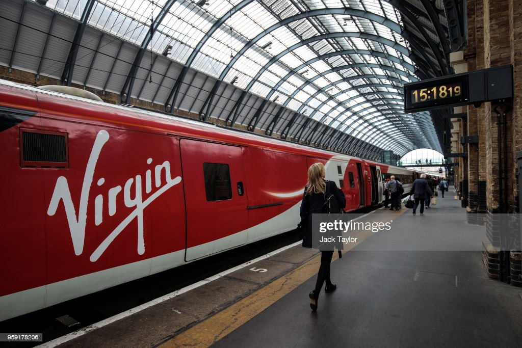 Passengers board a Virgin Trains East Coast train at Kings Cross Station on May 16, 2018 in London, England. East Coast trains are to be brought back under state control after Stagecoach and Virgin suffer a revenue shortfall on the £3.3bn contract to run the franchise.