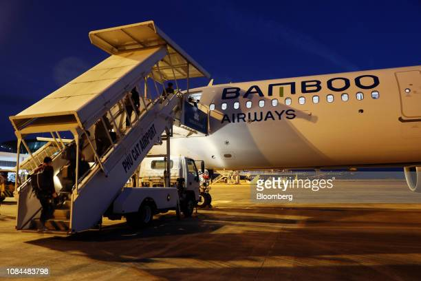 Passengers board an Airbus SE A321 Neo aircraft operated by FLC Group JSC's Bamboo Airways on the first day of the airlines's operations at Phu Cat...