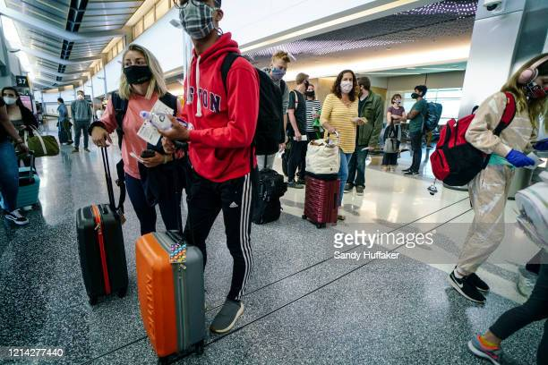 Passengers board an American Airlines flight to Charlotte North Carolina at San Diego International Airport on May 20 2020 in San Diego California...