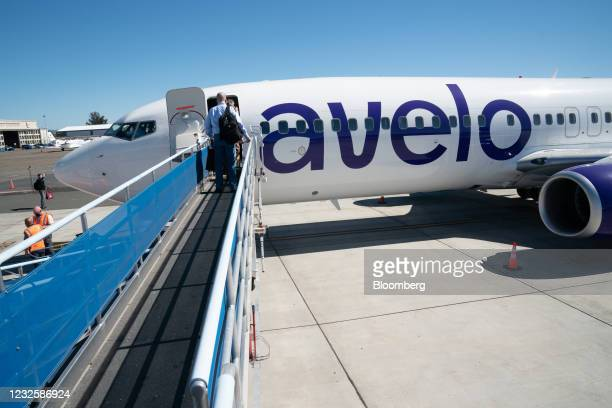 Passengers board an Avelo Airlines flight at Charles M. SchulzSonoma County Airport in Santa Rosa, California, U.S., on Wednesday, April 28, 2021....