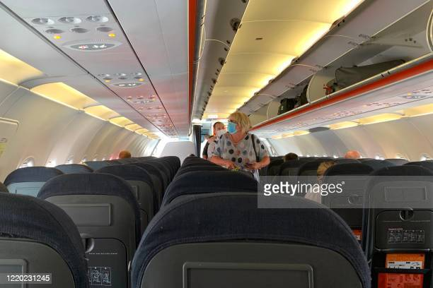 Passengers board an Easyjet domestic flight at an airport in the United Kingdom on June 15, 2020 as the low cost carrier resumes flights for the...