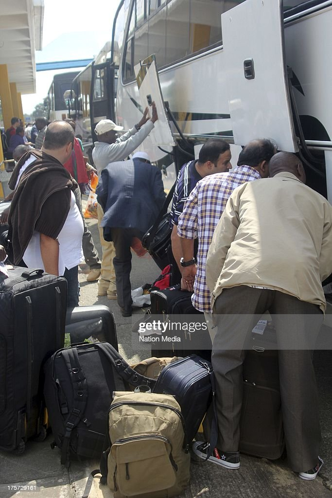 (Not for sale to The Star (Kenya), Capital FM, The People, Citizen TV, Kenya Broadcasting Corporation) Passengers board buses on August 07, 2013 in Nairobi, Kenya. Passengers were unable to leave after JKIA was closed indefinitely after fire gutted part of the international arrivals lobby.