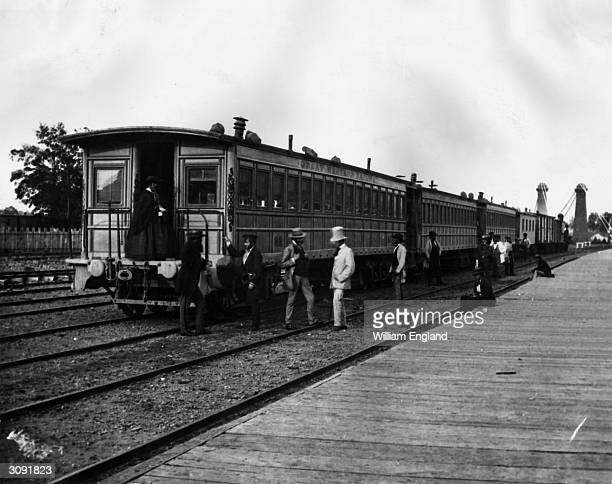 Passengers board carriages of the Canadian Great Western Railway at Clifton Depot Niagara