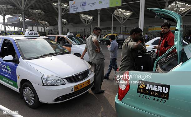 Passengers board radio taxis at the domestic terminal airport in New Delhi on January 27 2010 AFP PHOTO/Prakash SINGH