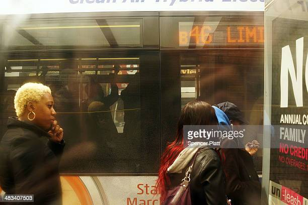 Passengers board the B46 bus on April 8 2014 in the Brooklyn borough of New York City The B46 bus which runs through parts of Crown Heights...