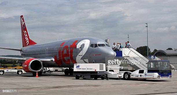 Passengers board the budget airline Jet2 com as it sits on the tarmac at the John Paul II International Airport Krakow Balice Ltd in Krakow Poland on...