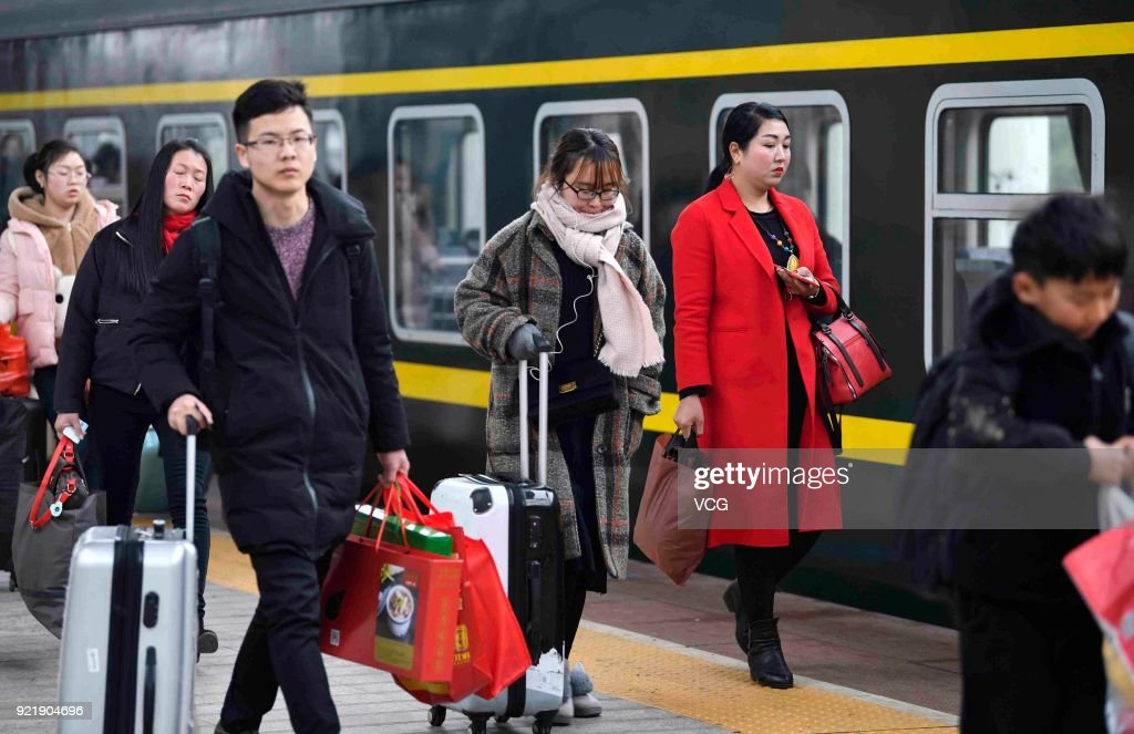 Passengers board the train as they started to return to school and work at Bozhou Railway Station on February 20, 2018 in Bozhou, Anhui Province of China. Bozhou Railway Station sees travel peak on the fifth day of the Lunar New Year.