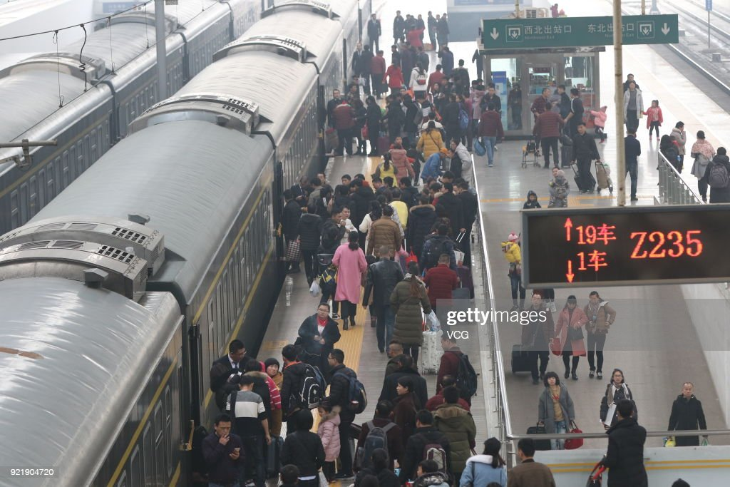 Passengers board the train as they started to return to school and work at Zhengzhou Railway Station on February 20, 2018 in Zhengzhou, Henan Province of China. Zhengzhou Railway Station sees travel peak on the fifth day of the Lunar New Year.