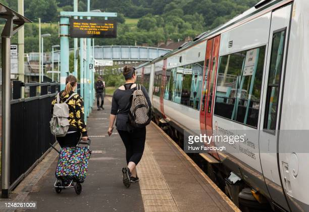 Passengers board the train at Newbridge train station on June 8, 2020 in Newbridge, Wales, United Kingdom. As the British government further relaxes...
