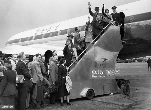Passengers boarding a British de Havilland Comet set for its inaugural flight to Johannesburg Original Publication Picture Post 5864 We're Flying...